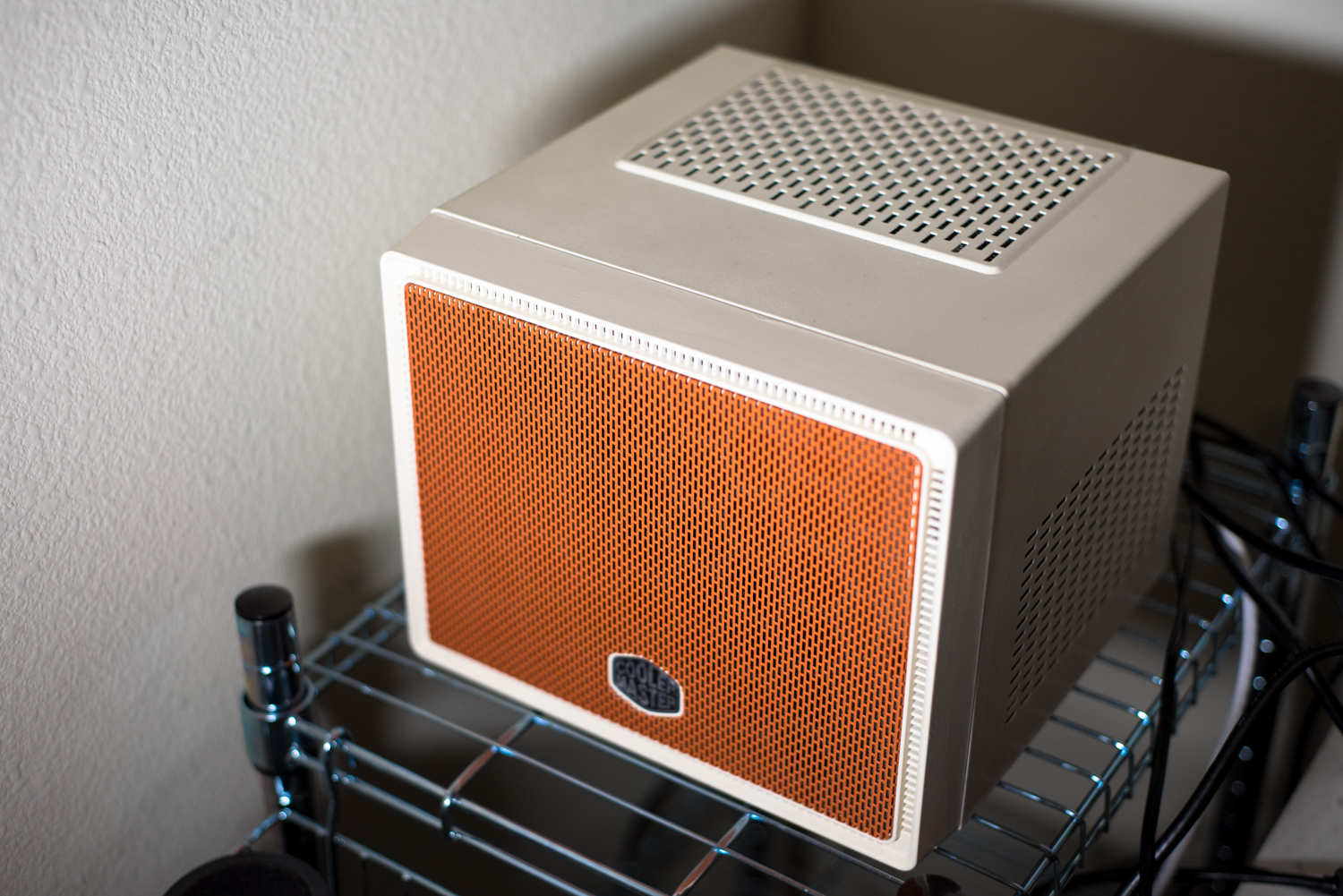 Orange and off white mITX Linux Computer
