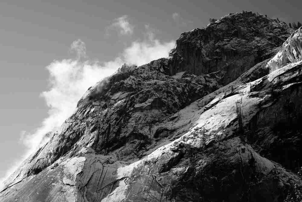 Black and white image of snow capped granite peak in Yosemite