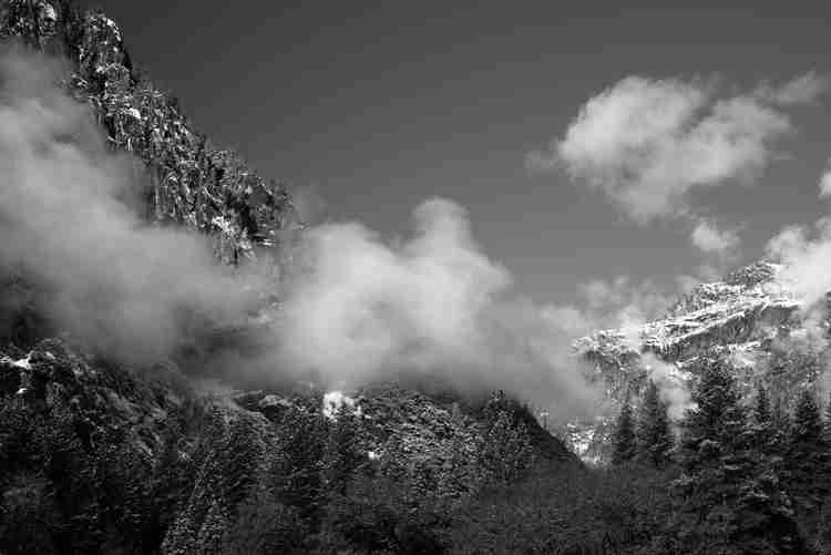Black and white image of snow capped granite peak in Yosemite