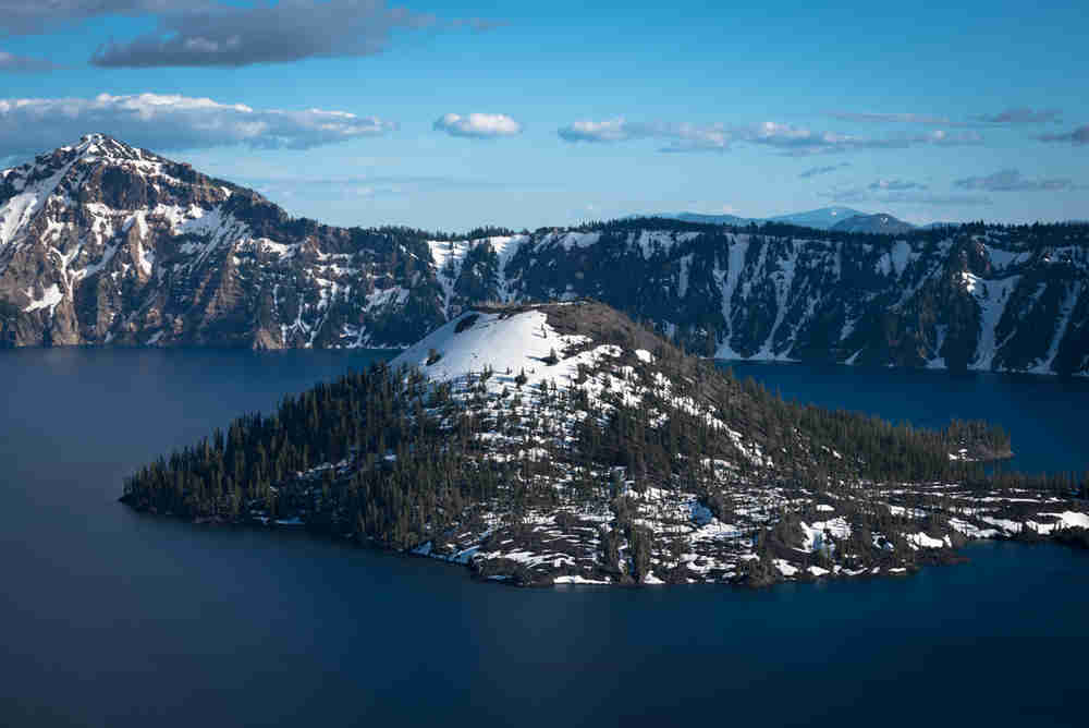 Snow covering the backside of Wizard Island at Crater Lake National Park
