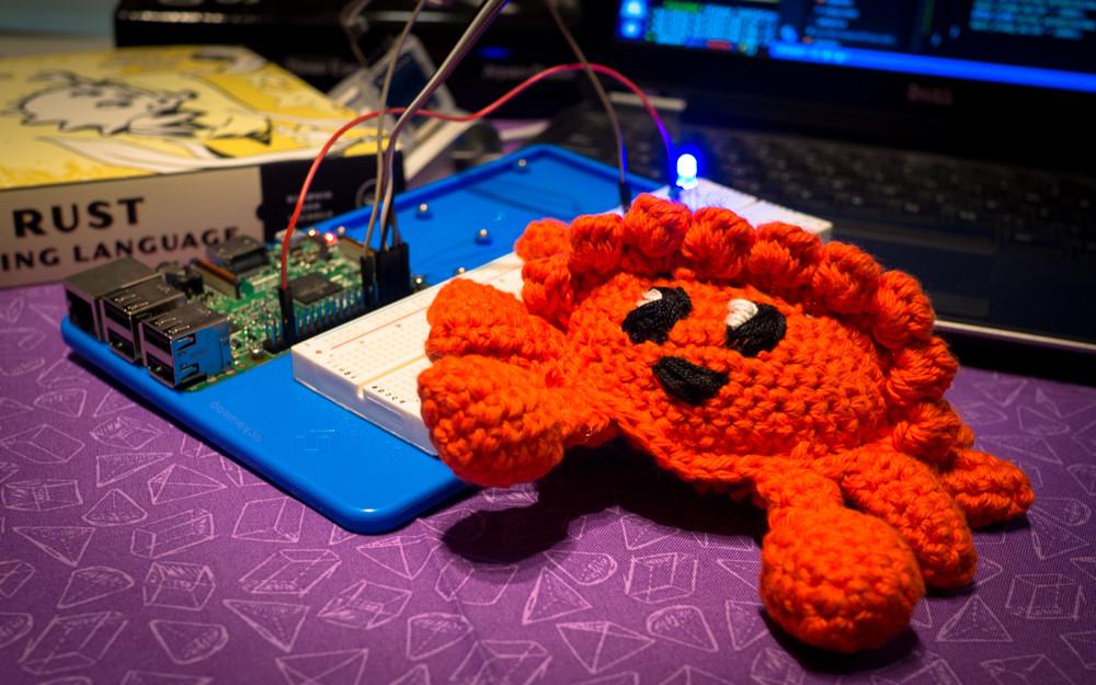 Raspberry Pi 3 running CS140e code with crocheted Ferris crab