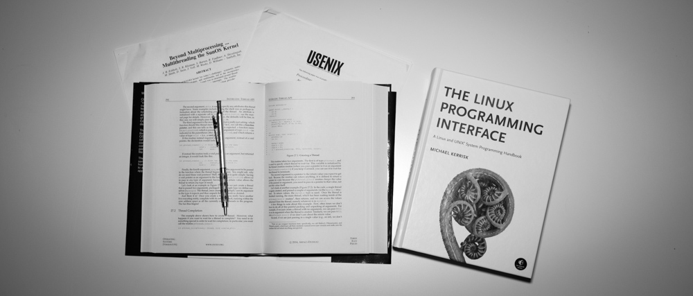 Open facing Operating Systems in Three Easy Pieces and closed The Linux Programming Interface books
